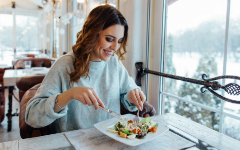 Mindful woman eating healthy food