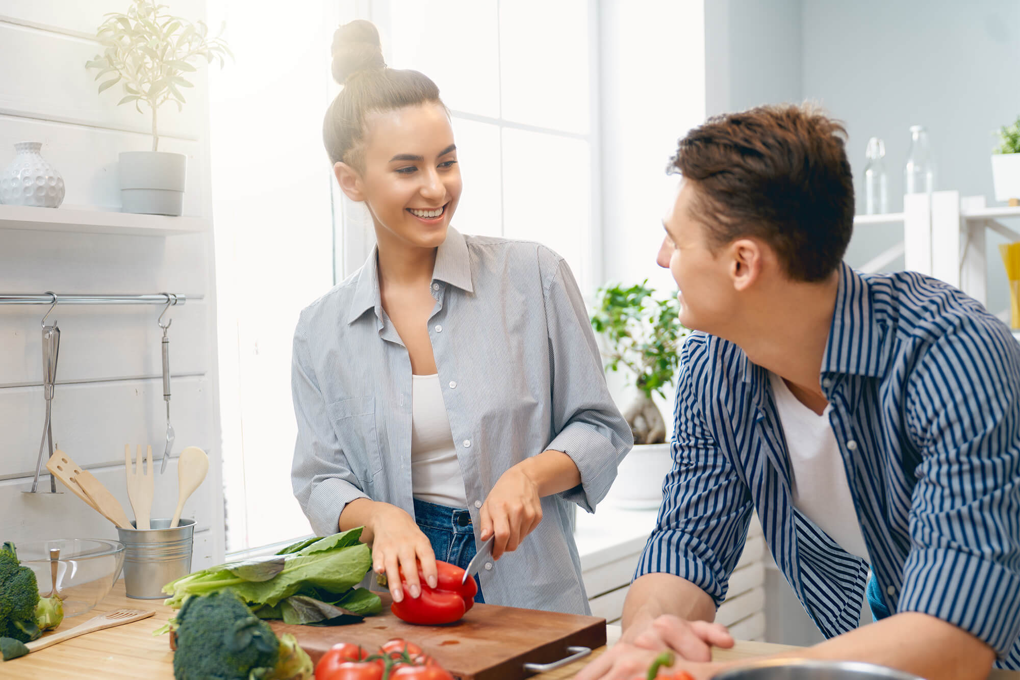 couple in kitchen with food