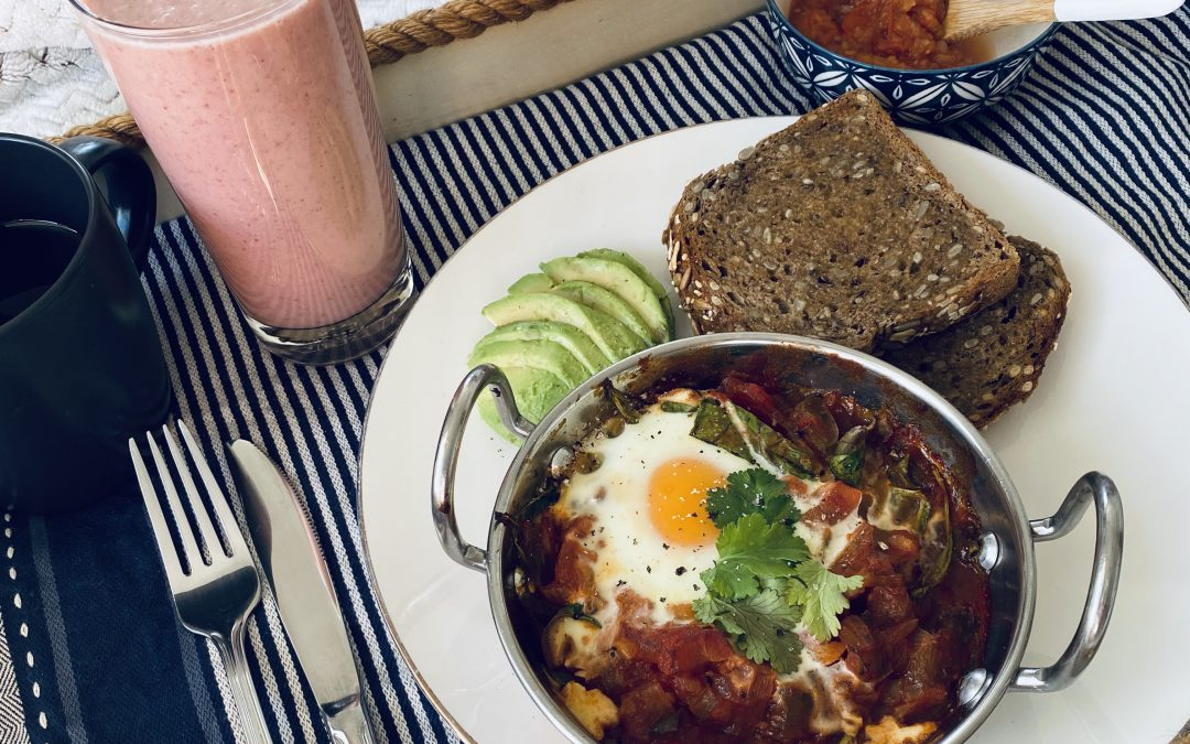 Shakshuka (Baked Eggs) with a Spiced Relish, served with a Fruity Smoothie
